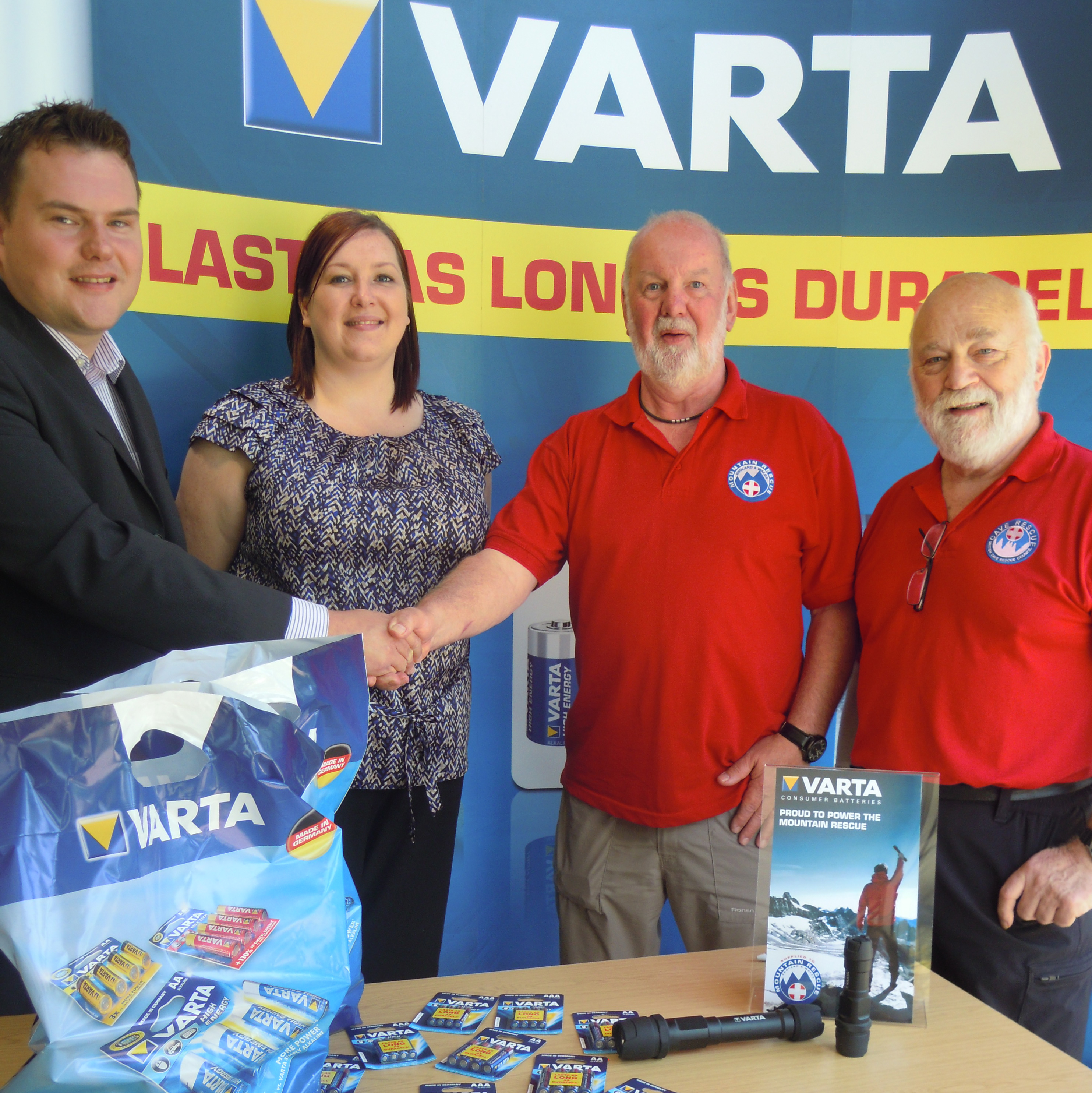 MREW national chairman Mike France and VARTA Consumer UK sales and marketing director Anthony Sewart sign a two-year deal which will see MREW teams across the UK 'powered' by VARTA's batteries and Indestructible torches